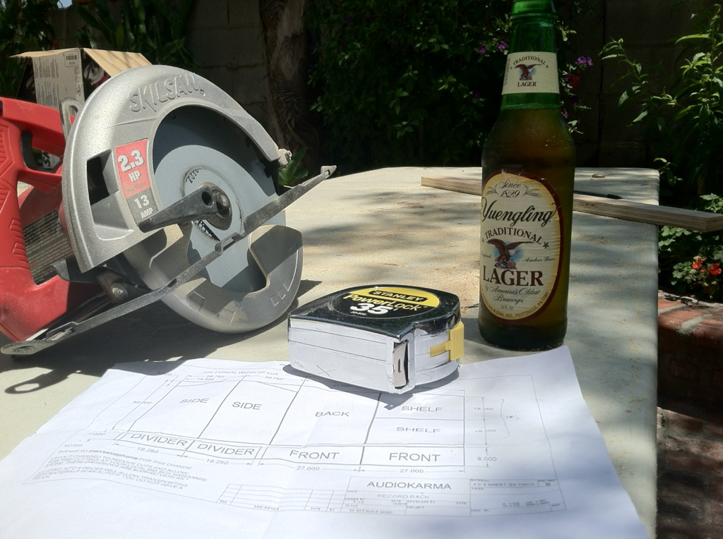 Hand saw, measuring tape and an ice cold Yuengling Lager