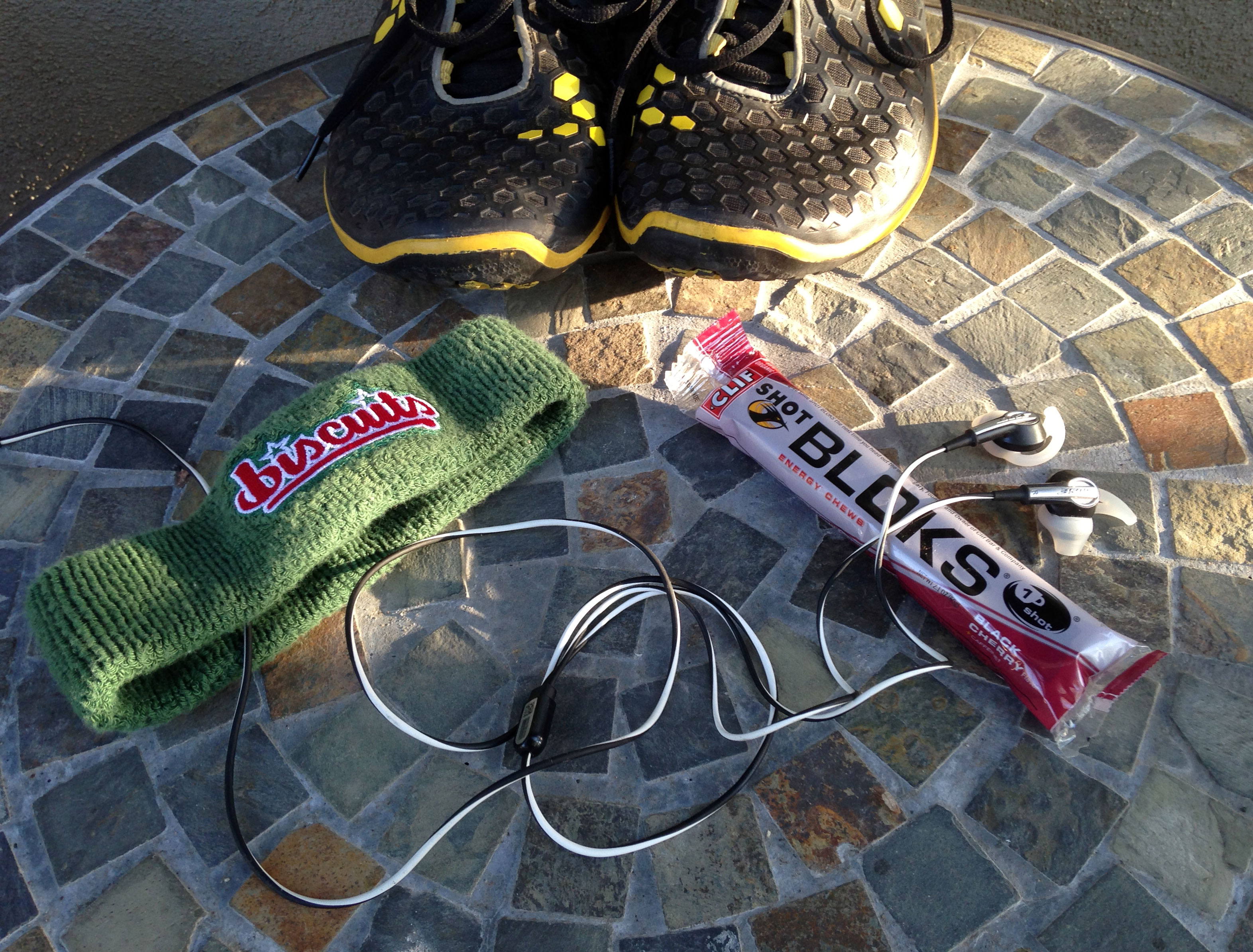 My running shoes, sweat band, Bose earplugs, and energy gels