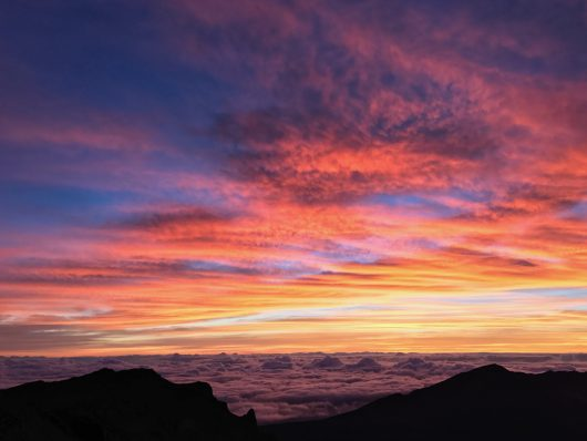 Haleakala Crater Sunrise over the clouds on Maui